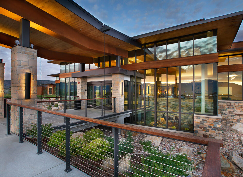 Outside of a Utah Skilled Nursing Facility -Healthcare Architecture that reflects the nature around it. Sunset reflecting in all glass front of building. Designed by TSA Architects. - senior living design firm.